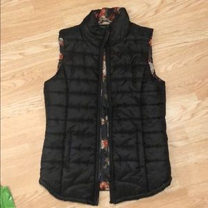 Black vest with floral pattern